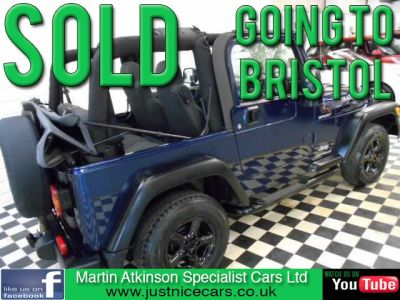 Jeep Wrangler 4.0 Sport 2dr 4X4 6 SPEED SOFT TOP~28000 MILES~ Convertible Petrol Sapphire Blue MetallicJeep Wrangler 4.0 Sport 2dr 4X4 6 SPEED SOFT TOP~28000 MILES~ Convertible Petrol Sapphire Blue Metallic at Martin Atkinson Cars Scunthorpe